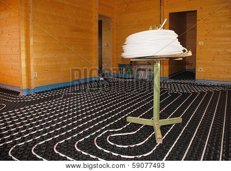 Underfloor Heating System In Wooden House