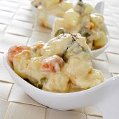 some small bowls with typical spanish ensaladilla rusa, russian salad, served as tapas poster