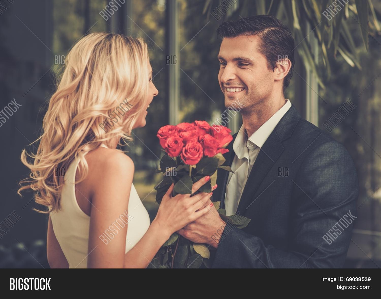 red roses dating Picture of handsome man with bunch of red roses dating his lady stock photo,  images and stock photography image 29540042.