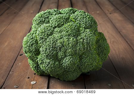 Broccoli On Brown Wooden Table