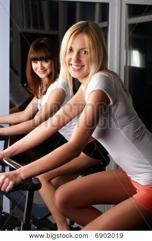 Two Charming Girls In A Sports Hall