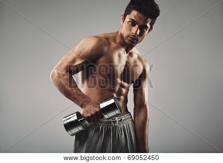 Hispanic Young Man Working Out With Heavy Dumbbell