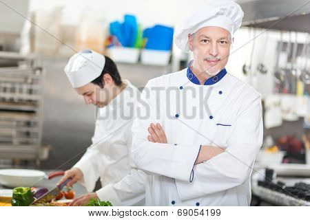 Portrait of a Chef at work in his Kitchen