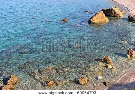 A greek rocky beach with clear water at south Pelion poster