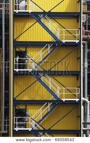 Fire-escape against yellow wall