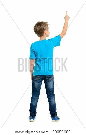 Rear View Of A School Boy Over White Background Pointing Upwards