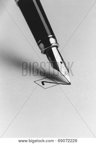 Tip of a Pen Checking a Box