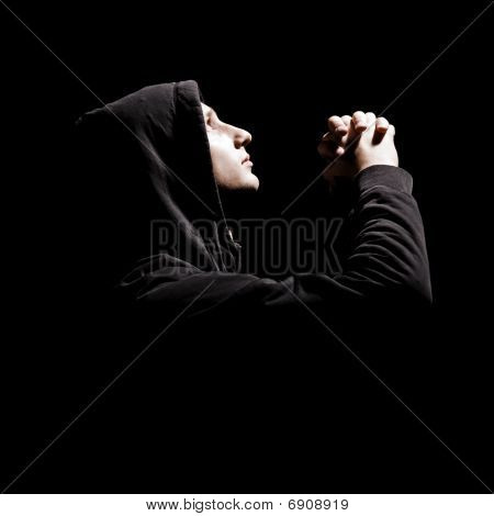 Young Man Is Praying