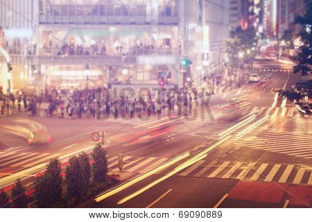Cars And People Crossing A Busy Tokyo Intersection