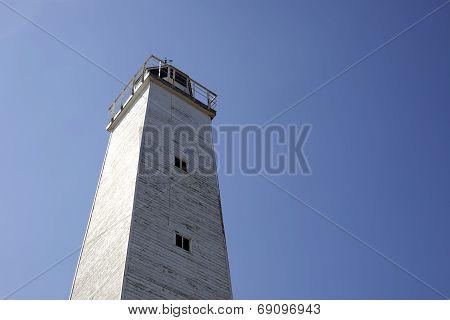 Old Wooden Lighthouse Under Blue Sky