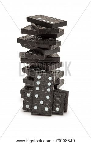 Black Dominoes Stacked In A Tower.