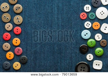 Closeup blue jeans background with different buttons. Space for your text.