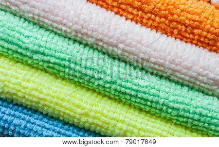 Closeup stack of colorful towels. Diagonal layout.