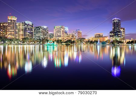 Orlando, Florida, USA downtown skyline at Eola Lake.