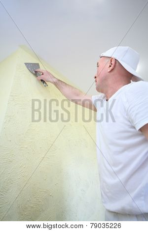 Plasterer making furnish the apartment with help of pallet