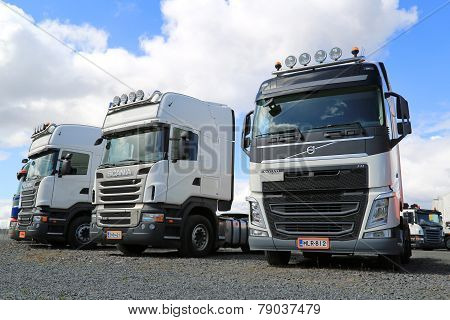 Row Of White Volvo And Scania Trucks