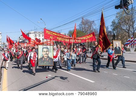 Tyumen, Russia - May 9. 2009: Parade of Victory Day in Tyumen. Members of Commubist Party of Russian Federation with Stalin portrait on parade poster