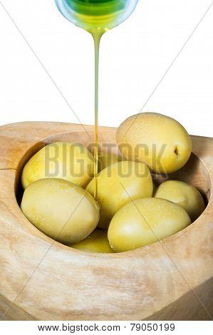 Olive Oil Flows From Bottle On Olives