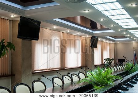 A large windows table and chairs in a modern conference room.