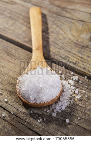 Old Brown wood spoon with salt cristals on wood table poster