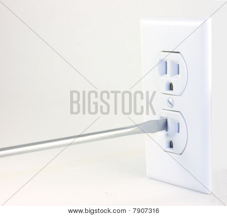 A Screwdriver Going Into An Outlet