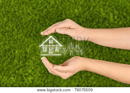 Two Woman's open hands making a protection gesture  isolated on green background.Property insurance and security concept. poster