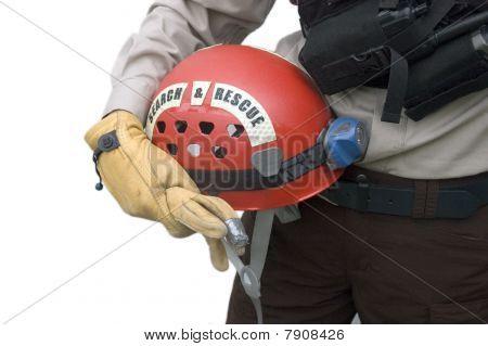 Rescuer Holding Helmet