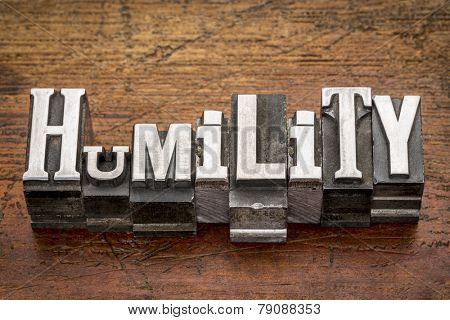 humility word in mixed vintage metal type printing blocks over grunge wood poster