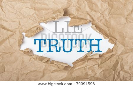 Truth And Lie Words On Paper And Torn Cardbox
