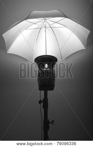 Detail of studio flash strobe light and umbrella on stand strobist professional photographer