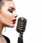 Singing Woman with Retro Microphone. Beauty Glamour Singer Girl Portrait. Isolated on White Background. Vintage Style. Karaoke Song  poster