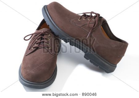 rugged casual shoes in brown suede on white background poster