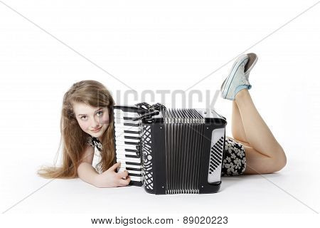 Teen Girl On The Floor In Studio With Accordion