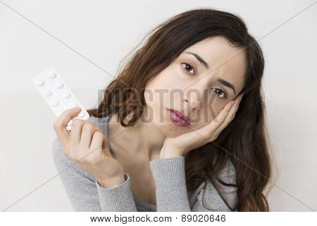 Woman Showing A Pack Of Pills