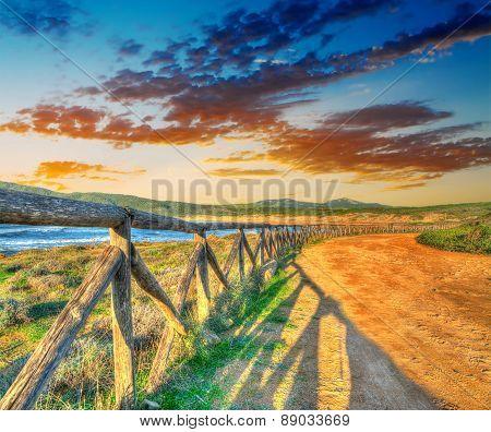 Colorful Sunset By Porto Ferro Shoreline