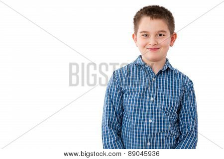10 Year Old Boy With Mischievous Smile On White