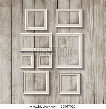 Frame template. Set of a frame on a wooden wall