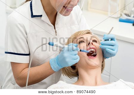 Woman Patient Undergoing A Dental Check