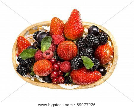 still life of heap multi-coloured berrys in basket on white background isolated poster
