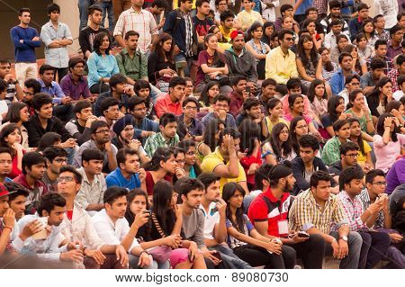 Crowd Of Young Students Watching