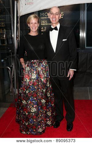 NEW YORK-APR 21: NBA Commissioner Adam Silver (R) and Maggie Grise attend the 2015 Time 100 Gala at Frederick P. Rose Hall, Jazz at Lincoln Center on April 21, 2015 in New York City.