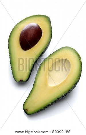 Halved avocado on white background