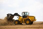 Front end loader clearing a construction site poster