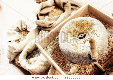 Ancient Millstone With Wheat Grains