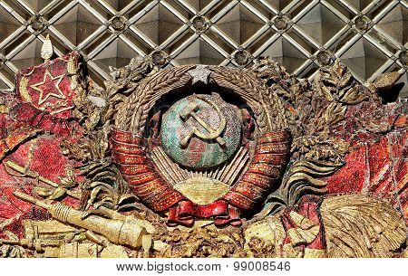 Hammer and sickle emblem of the Soviet Union on the building poster