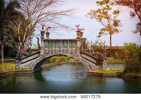 Ornate Bridge With Dragon Motif At Tirta Gangga In Indonesia