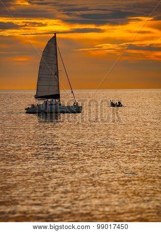 Catamaran Sailboat On A Tropical Sea At Sunset