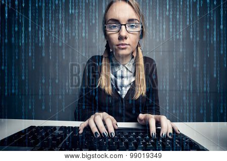 Nerd girl  using a computer with binary code on the screen