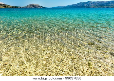 Beach in the coast of Adriatic Sea island Pag or Hvar. Turquoise and blue sea water of Adriatic and Mediterranean sea. Beautiful background landscape photo with calm sea water and blue skies. poster