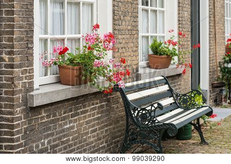 Windowsill With Pink And Red Flowering Pelargonium Plants